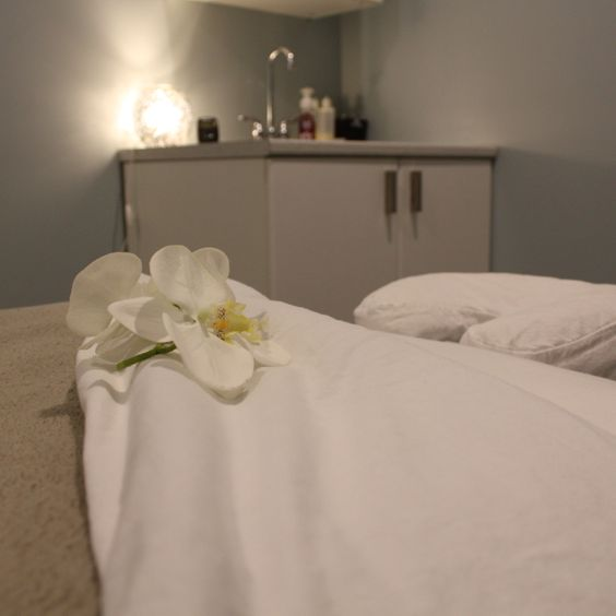 flowers on a massage therapy bed