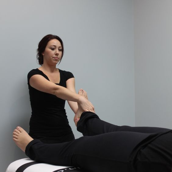 therapist working on foot of a client