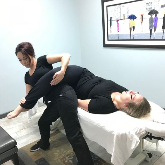 therapist giving massage therapy to a lady